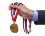Businessman holding gold medal