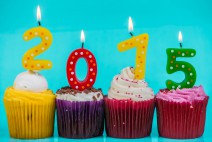 New Year 2015 colorful cup cakes on blue background