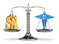 Choice health or money. Caduceus and dollar signs on scales.