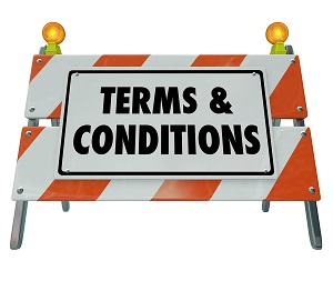 Terms and Conditions words on a road construction sign barricade to indicate rules and regulations for compliance